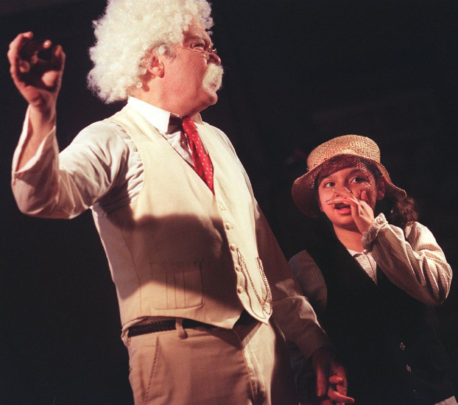 RJ file photo - Pond Hill School fifth-grader Carolina Estrada plays Huck Finn as David Paul Simon portrays Mark Twain, May 1999.