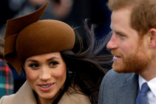 RESENDING TO PROVIDE AN ALTERNATIVE CROP OF SAN101- Prince Harry and his fiancee Meghan Markle arrive to attend the traditional Christmas Day service, at St. Mary Magdalene Church in Sandringham, England, Monday, Dec. 25, 2017. (AP Photo/Alastair Grant)
