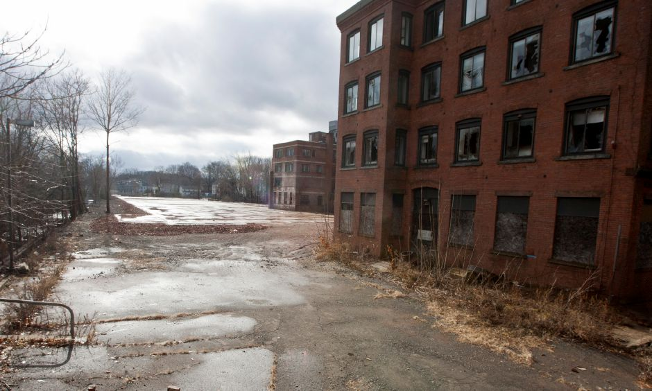 The former medical office building at 116 Cook Avenue, at right, stills stands next to where the former Factory H stood before is was demolished in 2012 in Meriden, Jan. 14, 2013. (Christopher Zajac / Record-Journal)