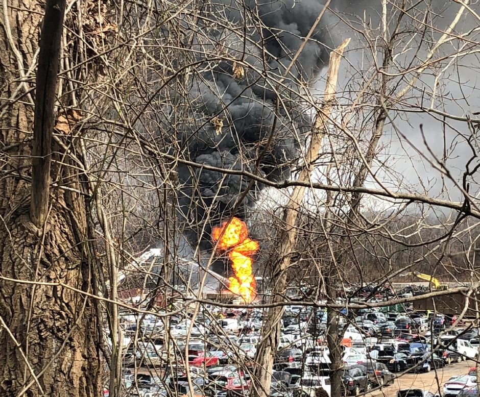Fire and smoke rising Chuck and Eddy's auto salvage yard on Old Turnpike Road in Southington Tuesday as seen in a photo taken by a neighboring resident. | Courtesy Lindsay Betzendahl.