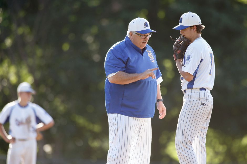 Meriden Post 45 head coach Doug Wedge, seen here talking with pitcher Justin Kolesar during an American Legion baseball game last summer, will have to rely on the ability of his players to play multiple positons to overcome their small numbers in 2019. | Justin Weekes / Special to the Record-Journal
