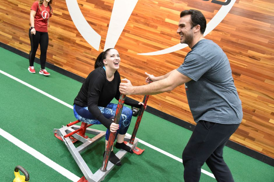 "Former ""The Bachelorette"" contestant and Meriden resident Matt Munson works out with fellow city resident Noel Tufano, who on Tuesday won The Edge sweepstakes to work out with Munson for Valentine"