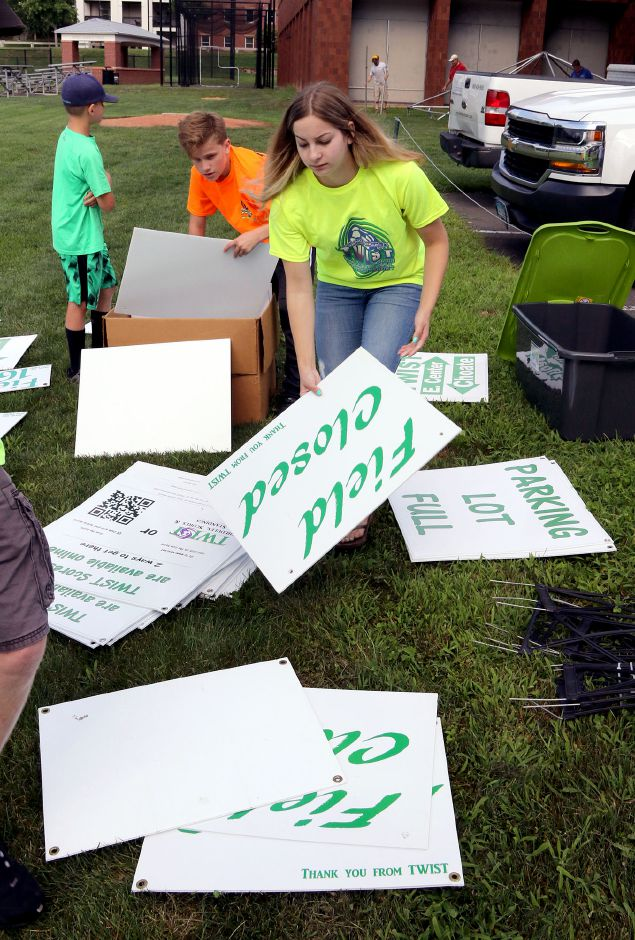 Talan Burr 13 left and Isabella Stowik 18 both from Wallingford, sort through signs at Choate Rosemary Hall as they get ready for the 35th annual TWIST soccer tournament on Friday August 16, 2019. Aaron Flaum, Record-Journal Staff