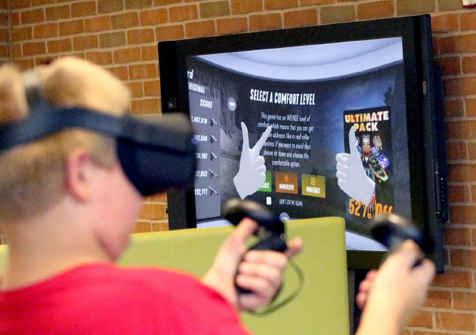 Atreyu Jordan 12 of Meriden, selects a comfort level before taking a Virtual Reality roller coaster ride during a Virtual Reality Experience for Teens class at the Collaboratory at the Wallingford Public Library on Tuesday August 13, 2019. Aaron Flaum, Record-Journal Staff