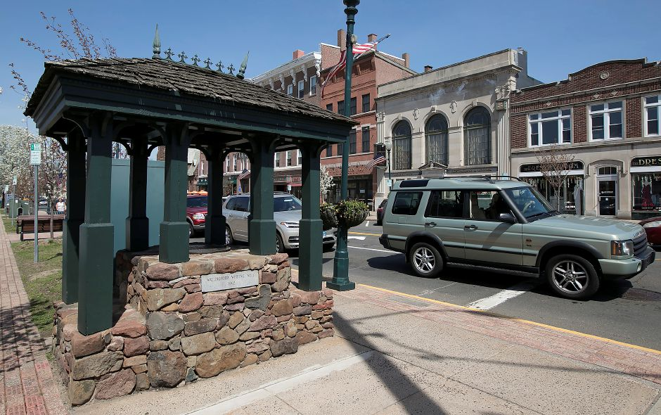 The Wallingford Wishing Well, at the intersection of North Main and Center streets in Wallingford, was installed in 1992. Below, the plaque on the well. Dave Zajac, Record-Journal