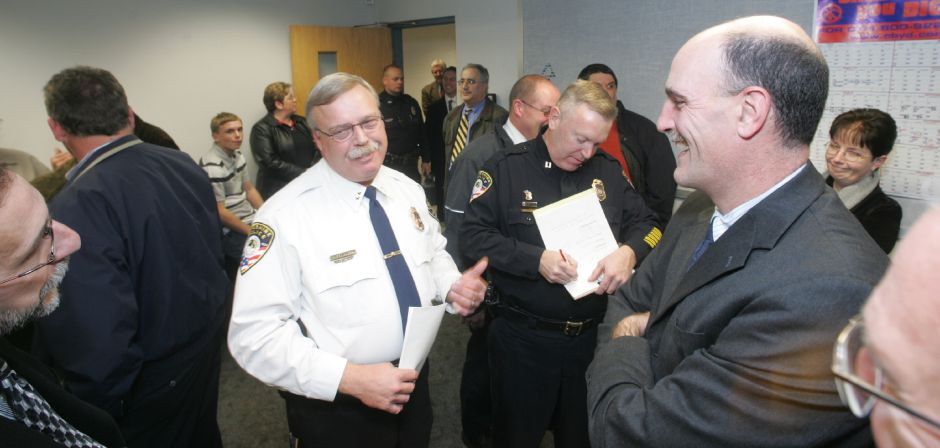 Cheshire Police Chief Chris Loudon, center, speaks with friend at his swearing in ceremony November 17, 2005. On the right is Cheshire Superintendant of Schools Greg Florio. Chris Angileri/Record-Journal.