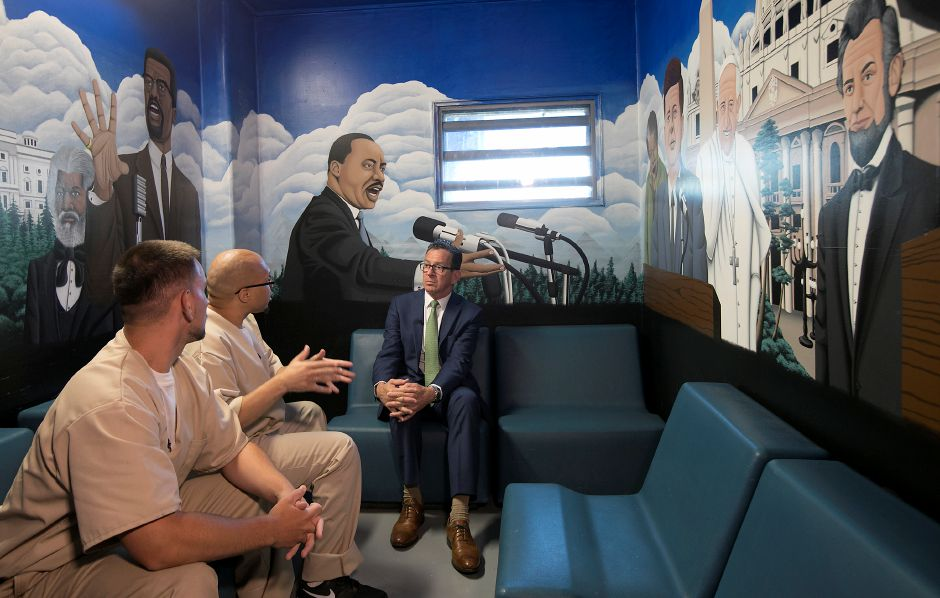 Inmates, Festim Shyuqeriu, 24, of New Britain, left, and Isschar Howard, 39, of New Haven, second from left, talk with Governor Dannel P. Malloy in The Spot conversation room at Cheshire Correctional Facility Wednesday, May 30, 2018. The room is reserved for respectful conversation on a lighter level or any specific topic from religion and politics to music and movies. Dave Zajac, Record-Journal