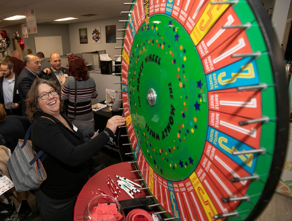 "Lisa Cidela, a licensed customer service agent with Horton Insurance Services LLC, gives the money wheel a spin during the 2nd Annual Record-Journal 4-Chamber Social ""Casino Night"" at the Record-Journal on South Broad Street in Meriden on Wednesday evening."