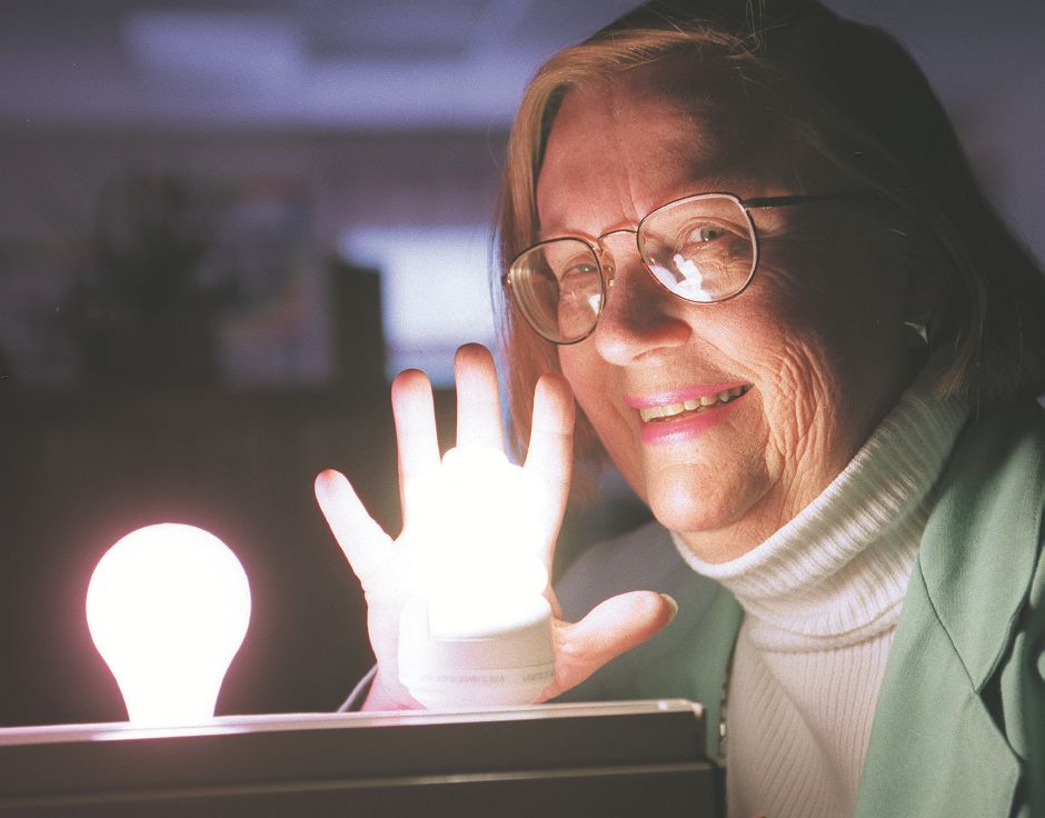 Rj file photo - Carol A. Wilson, President of Wilson Educational Services, Inc., poses with her hand behind an energy saving fluorescent light. Formerly a teacher at Sheehan Elementary School in Wallingford, Wilson started her own business that teaches about energy efficiency, May 1999