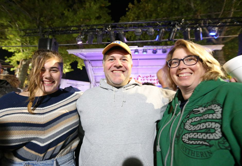 Maya, left, Seth, and Kathy Wrinkleman in front of the main stage getting ready for the Spin Doctors concert at the annual Apple Harvest Festival in Southington on Saturday, Oct. 12, 2019. Emily J. Tilley, special to the Record-Journal.