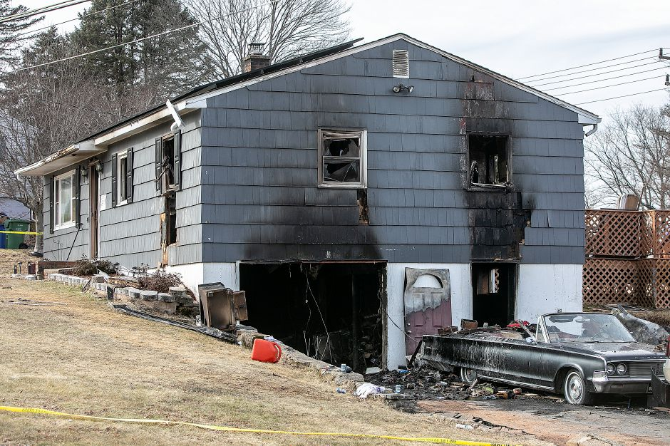 A house damaged by fire at 40 Side Hill Road in Meriden. A man authorities were searching for following the fire Monday was found dead nearby. Dave Zajac, Record-Journal