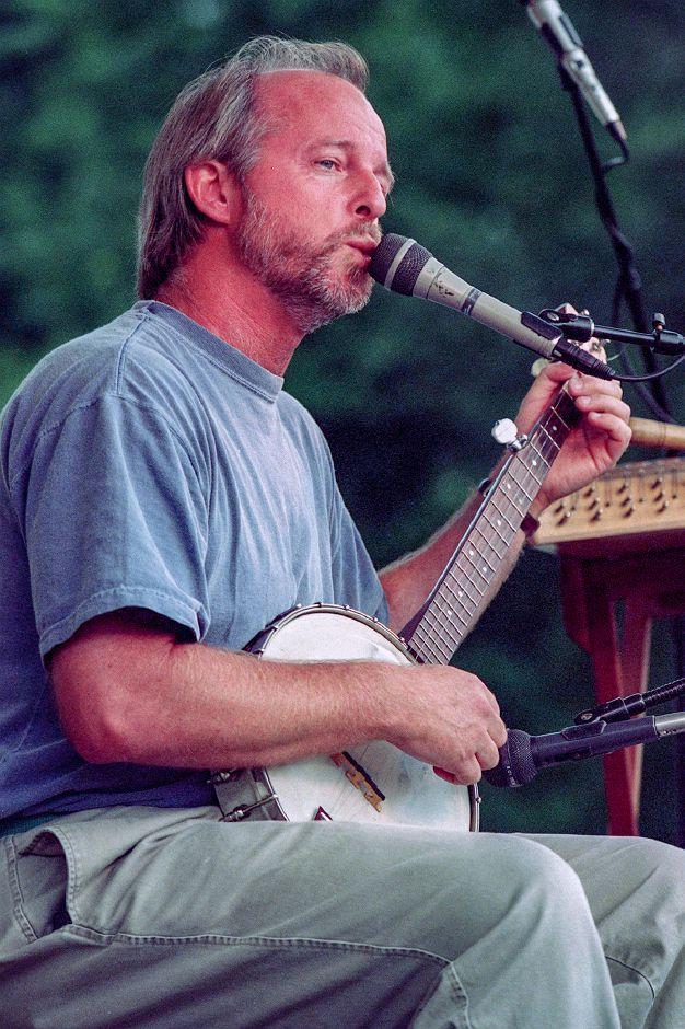 "Mark Rust, of Woodstock, N.Y., plays the 5-string banjo and sings the""Kissing Song"" during a concert at Doolittle Park Wed., July 14, 1999."