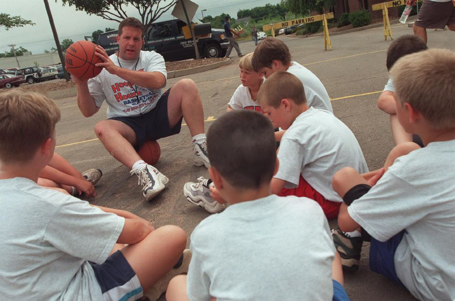 Thomas Kuntz, an instructor with The Hoop House Basketball Camp, talks to his team about the next basketball drill they will do, July 1999.