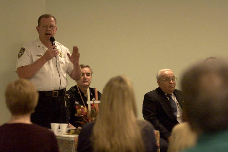 Major Gary Walberg of the Cheshire Police Department, left, speaks to a room full of senior citizens at Southwick of Cheshire Thursday morning October 19, 2000. In the middle is Officer Tom Stretton, and Rep. Al Adinolfi. The subject of the meeting is Senior Safety Day.