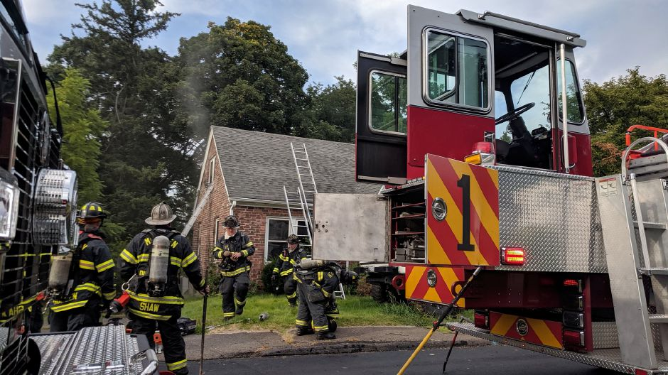 Firefighters battled a house fire on Atkins Street Extension late Tuesday afternoon. | Mike Gagne, Record-Journal.