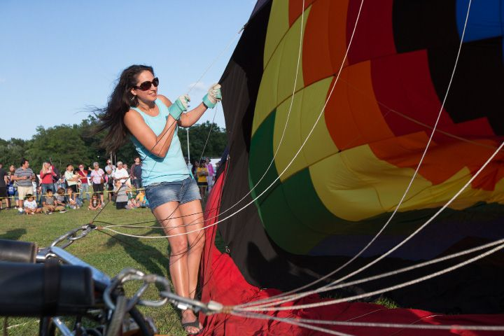 Jennifer Okoski of Litchfield holds a hot air balloon as it