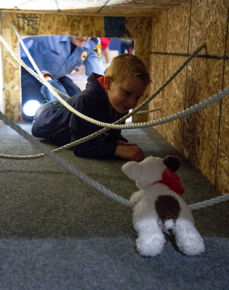 Logan Nadeau, 5, of Bristol, saves a stuffed puppy in the Plainville Fire Department