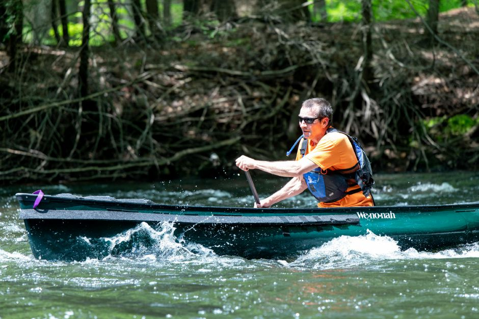 A paddler goes through rougher water in the Quinnipiac Downriver Classic race on May 19, 2019. The yearly kayak and canoe race attracted 35 participants this year, going from the Meriden-Waterbury Turnpike to the Red Bridge on Oregon Road in Meriden. Devin Leith-Yessian/Record-Journal