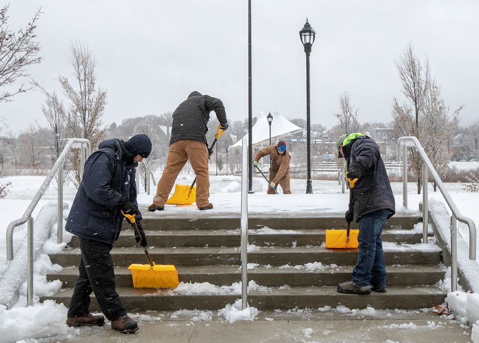 City crews work to clear ice and snow from stairs on the Meriden Green, Mon., Dec. 2, 2019. Dave Zajac, Record-Journal