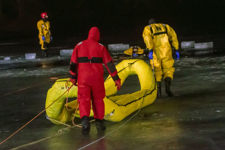Firefighters head out to the icy training on Papergoods Pond Monday night Feb. 4, 2019. | Ron Paris, Special to the Record-Journal