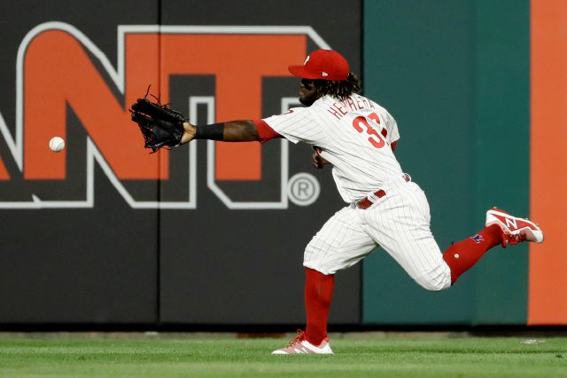 Philadelphia Phillies center fielder Odubel Herrera cannot reach a three-run double by Boston Red Sox