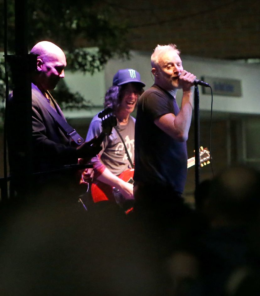 Spin Doctors guitarists Mark White, left, Eric Schenkman and lead singer Chris Barron entertains the crowd during the concert on the main stage at the annual Apple Harvest Festival in Southington on Saturday, Oct. 12, 2019. Emily J. Tilley, special to the Record-Journal.