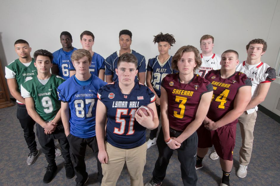 Introducing the offensive unit of the 2017 All-Record-Journal Football Team. Front and center is Lyman Hall's Andrew McClure. He is flanked, left to right, by Maloney's Aden Valentin (No. 9), Southington