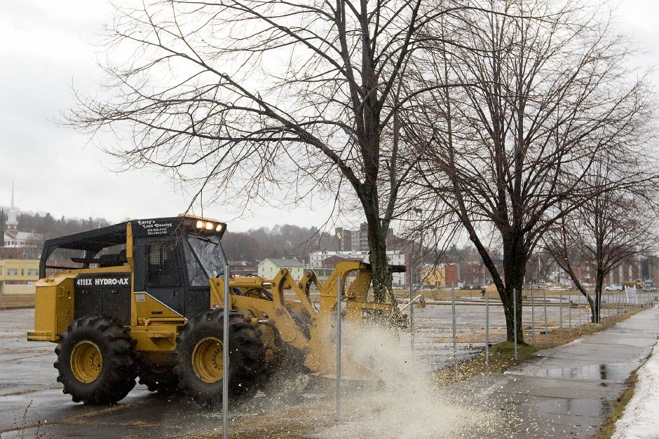 A Hydro-Ax machine with roto saw attachment makes quick work of several small trees along the perimeter of the HUB property in downtown Meriden, Monday, January 6, 2014. Removal of the trees was the first step to the redevelopment of the HUB. | Dave Zajac / Record-Journal