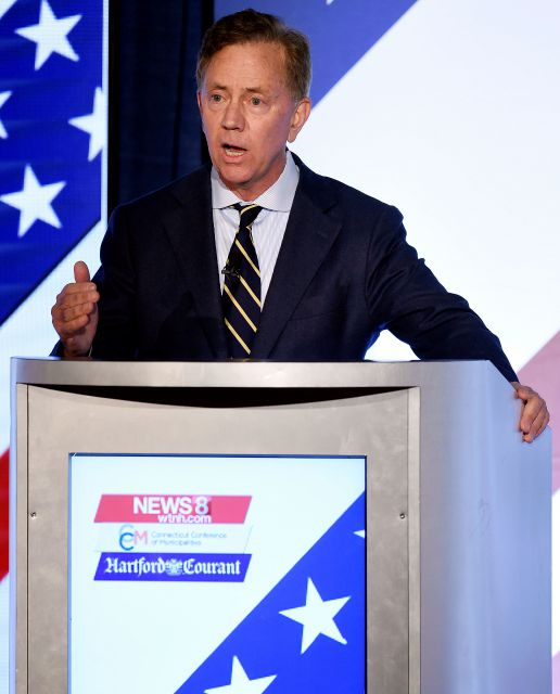 Democrat Ned Lamont answers a question as he and the other two leading candidates for Connecticut Governor; petitioning candidate Oz Griebel, and Republican Bob Stefanowski, face off in their final gubernatorial debate one week before the election Tuesday, Oct. 30, 2018 at at the Premier Ballroom at Foxwoods in Ledyard, Conn. (Sean D. Elliot/The Day via AP)