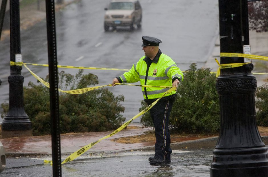 A Meriden police officer tapes off the intersection of Cook Avenue and Hanover Street due to heavy flooding from storm Irene Sunday morning August 28, 2011. (Dave Zajac/Record-Journal)