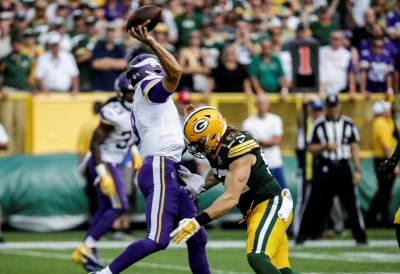 FILE - In this Sept. 16, 2018, file photo, Green Bay Packers' Clay Matthews tackles Minnesota Vikings quarterback Kirk Cousins during the second half of an NFL football game, in Green Bay, Wis. Matthews was penalized for roughing the passer on the play. The NFL is getting roughed up over its amplified enforcement of roughing the passer penalties that has produced head-scratching, game-changing calls and a season-ending injury to a defender trying to comply with the league's mandate not to land on the quarterback. What constitutes a clean hit anymore is anyone