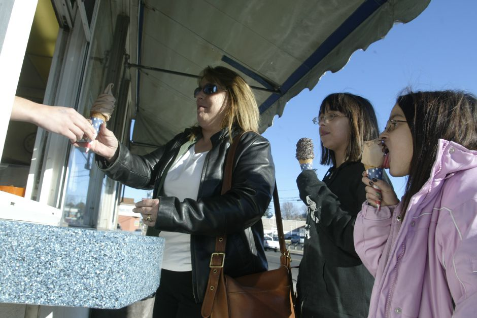 Gail Nevarez, left, gets handed an ice cream cone at Les