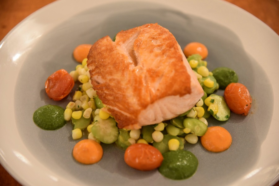 The Atlantic salmon with corn, fava beans, grae tomatoes, romesco, and cilantro chimichurri, offered at Kala Bistro in North Haven, on Thursday, Dec. 6, 2018. | Bailey Wright, Record-Journal