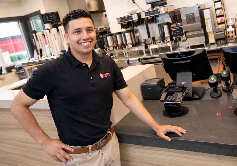 Herky Cedillo, manager, stands in the newly-renovated Dunkin' Donuts store at 1101 N. Colony Road in Wallingford on Thursday. The store is slated to open next week. Dave Zajac, Record-Journal