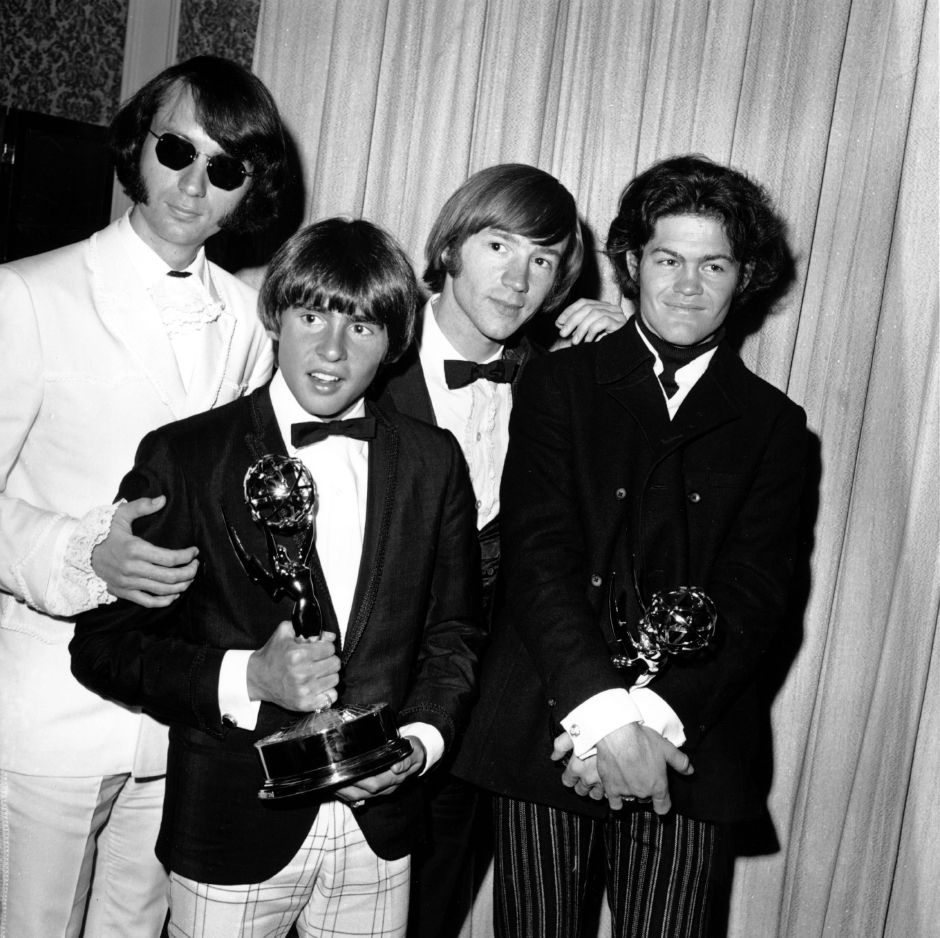 "The Monkees pose with their Emmy award at the 19th Annual Primetime Emmy Awards in Calif. on June 4, 1967. They won for best comedy series and best comedy direction for their television program ""The Monkees."" The group members are, from left to right, Mike Nesmith, Davy Jones, Peter Tork, and Micky Dolenz. (AP Photo)"