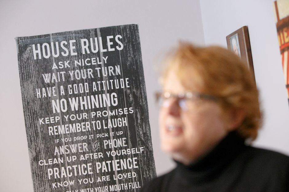 "A ""House Rules"" sign provides a structure for daily living to help residents at the Bridge Family Center Winifred House in Southington.  Justin Weekes, Special to the Record-Journal"