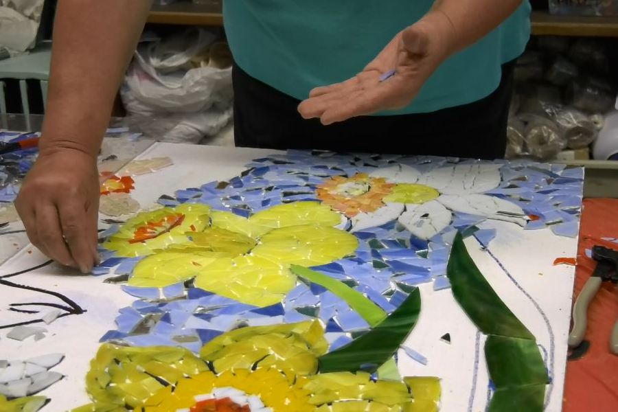 Webster works on a mosaic mural. Ashley Kus, Record-Journal