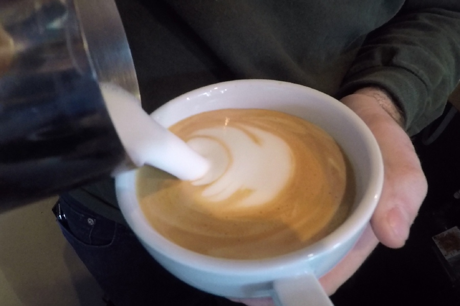Coffee Production member Dan Follett creates some latte art at Rebel Dog Coffee Co., 393 Farmington Ave., Plainville. |Ashley Kus, Record-Journal
