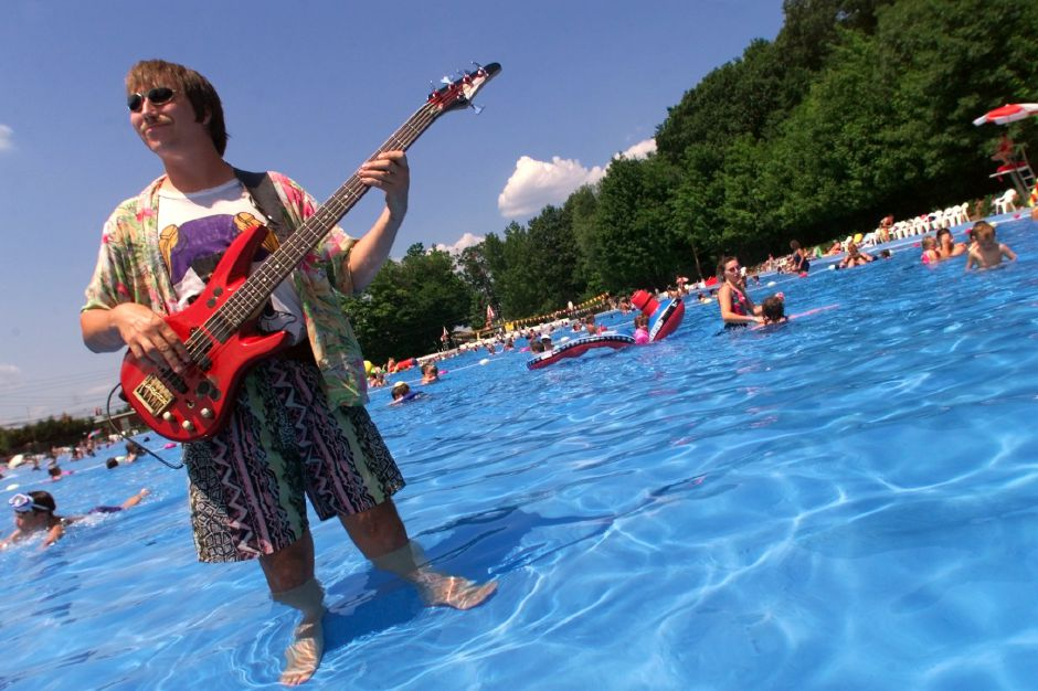 Jason Pierce of Higganum, a bassist with the Killingworth- based band, The Beach Bums, plays a little surf music with his wireless guitar and gets a little wet during Wallingford Community Pool
