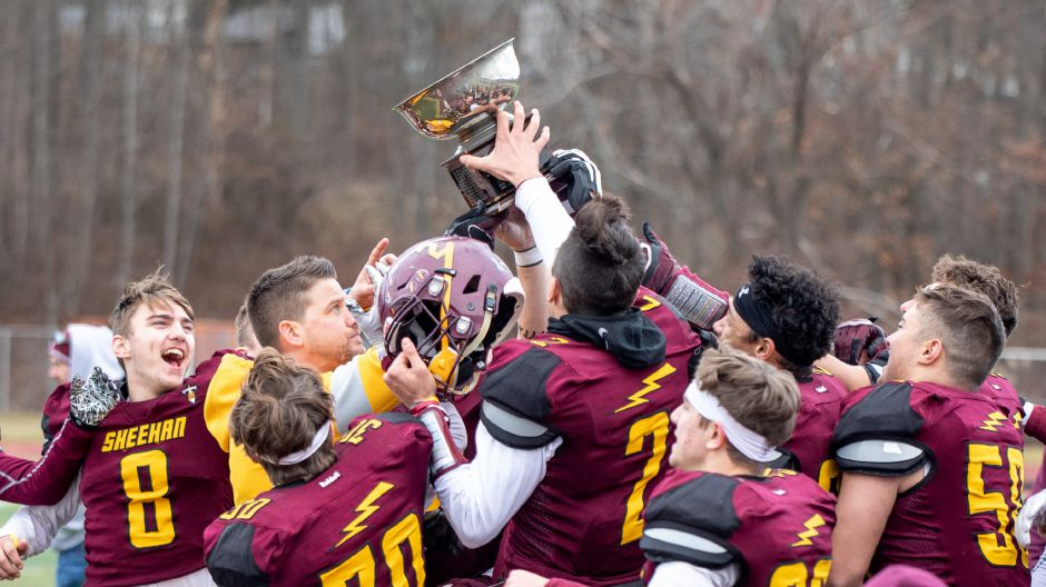 Head coach John Ferrazzi and the Sheehan Titans hold up the Carini Bowl after defeating Lyman Hall 56-0 on Thursday at Riccitelli Field in Wallingford. The win was the most lopsided in series history and it clinched a Class S playoff berth for the 8-2 Titans.