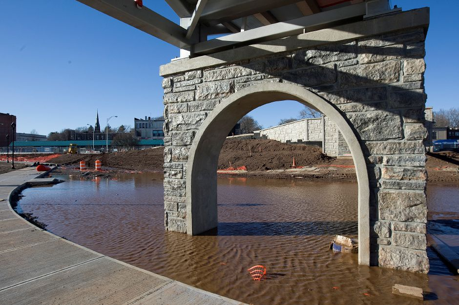 Standing water from heavy rains under the pedestrian bridge on the Hub site in downtown Meriden, Monday, Jan. 11, 2016. As flood control, nearly everything on the site is designed to be submerged. | Dave Zajac / Record-Journal