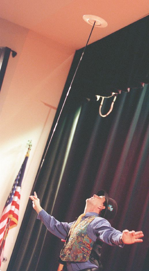 RJ file photo - Ken Sprano, of Watertown, entertains students at Kennedy Middle School in Southington by spinning a plate on a long pole, March 1999.