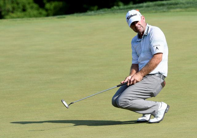 Ryan Armour is one of six golfers tied atop the leaderboard at 6-under par after one round of the Travelers Championship at TPC River Highlands. (AP Photo/Nick Wass)
