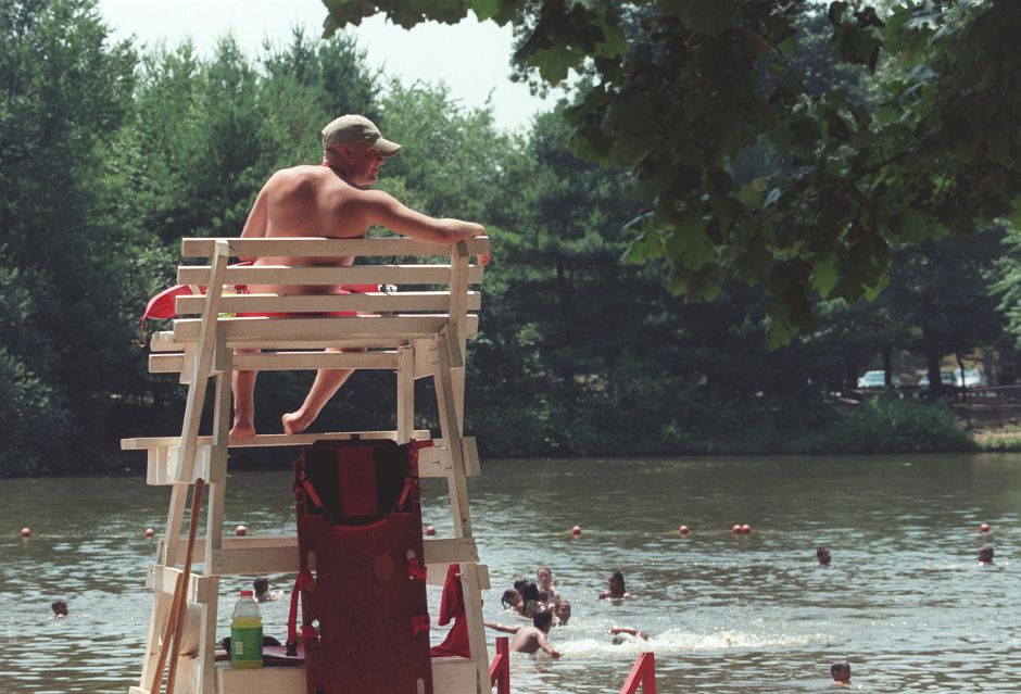 Robert Lalla, of Southington, sits in his chair lifeguarding at the Wharton Brook State Park July 6, 1999. The swimming area in the Wharton Brook State Park is in Wallingford.