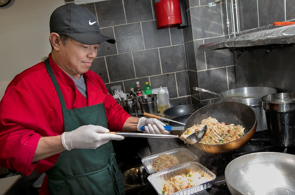 Chef Chan Chaoraingoen cooks up fried rice on Friday  at the new Thai-Tanic Cuisine, 784 E. Main St. in Meriden. Dave Zajac, Record-Journal