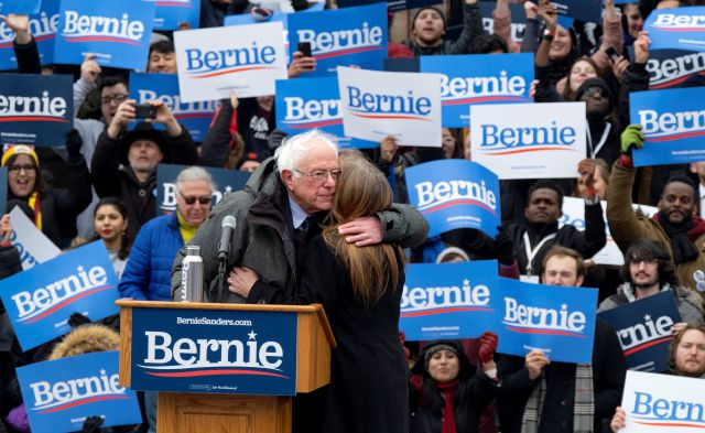 Sen. Bernie Sanders, I-Vt., hugs his wife Jane after he finished speaking  Saturday, March 2, 2019, in the Brooklyn borough of New York.  Sanders returned to Brooklyn, his birthplace, for the first rally of his second presidential campaign and sought to tie his working-class background to his populist views that are helping reshape the Democratic Party. (AP Photo/Craig Ruttle)