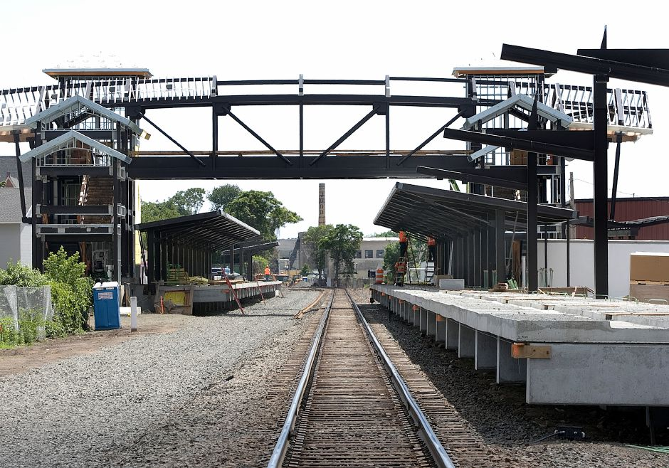 Workers continue construction of a new train station near the intersection of North Cherry Street and Parker Street in Wallingford, Friday, June 24, 2016. The cost of parking in a 221-space lot near downtown Wallingford will be discussed when advisors to the CTRail Hartford Line meet soon to iron out more details of increased commuter rail service from New Haven to Springfield. | Dave Zajac, Record-Journal