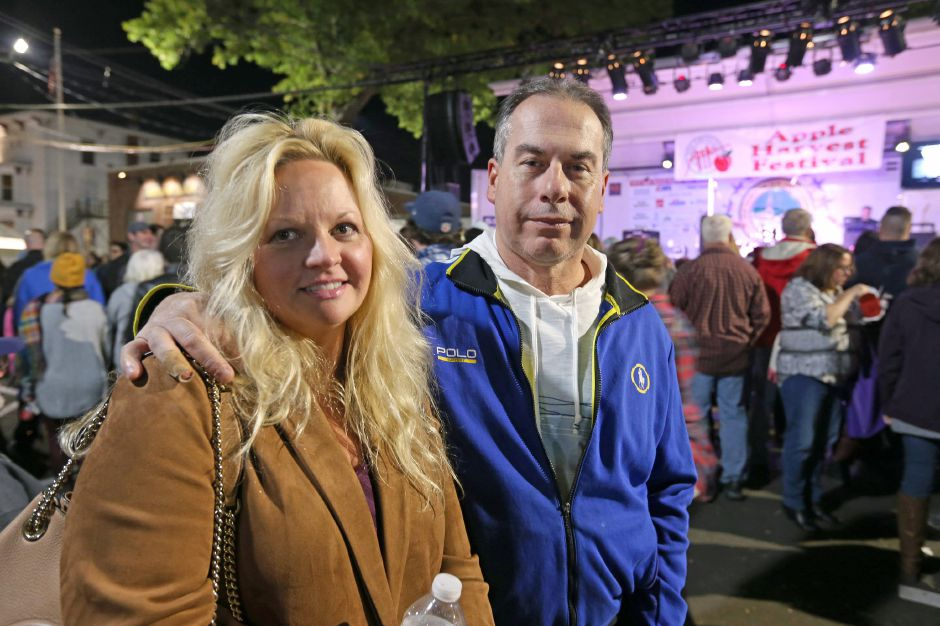 Lori Amundson and her fiance, Joe Frasca, get a good spot in front of the main stage for the Spin Doctors concert at the annual Apple Harvest Festival in Southington on Saturday, Oct. 12, 2019. Emily J. Tilley, special to the Record-Journal.