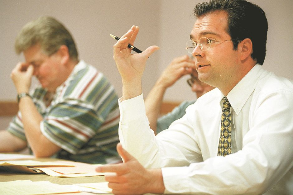 RJ file photo - Joseph Ferringo Feest addresses the MCAA board while John Thorpe listens during a meeting May 28, 1998. Both are board members.