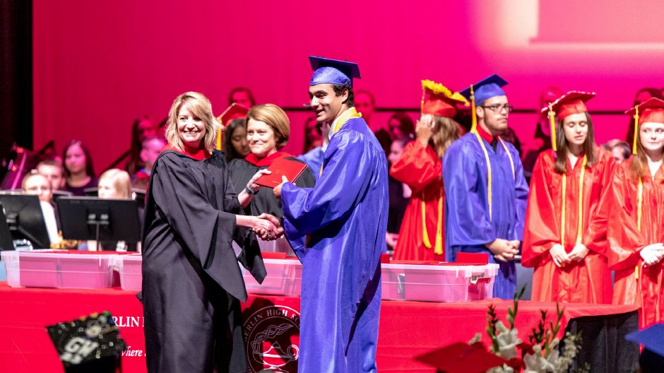 Berlin High School Principal Eileen Eustis hands a student his diploma during the 2019 cermony, held at Central Connecticut State University on June 16, 2019. | Devin Leith-Yessian/Record-Journal